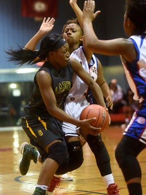 Captain Shreve's Aaliyah Stevenson drives to the basket during a game against Evangel this season. Both the Gators and Eagles are headed to the state playoffs as high seeds.