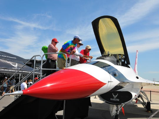 Spectators check out a Thundrbird jet. The TICO Warbird Airshow got underway Friday starting the show with a Navy F/A 18C and the USAF Thunderbirds.