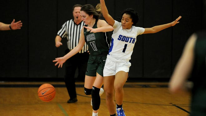 Sheldon's Ali Mirabile (11), seen her getting fouled by South Medford's Toni Coleman in a Southwest Conference game this past season, was a four-year starter for the Irish and the 2019 conference player of the year.