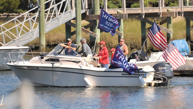 President Trump supporters head out in their decorated boat from the Marshfied Yacht Club to join the President Trump boat parade in Marshfield, Saturday, Sept. 5, 2020. Tom Gorman/For The Patriot Ledger