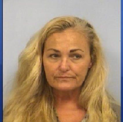 Martha Carolyn Dreher, 57, is charged with arson.