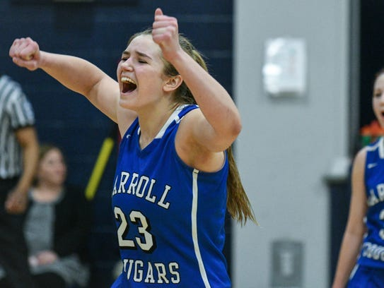 Carroll's Megan Herr, left, celebrates as her and teammate
