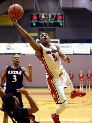 Stewarts Creek's Jalen Fearn flies in the air toward the basket. Fearn has signed with Martin Methodist.