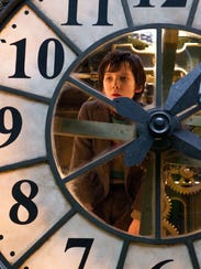 "Asa Butterfield as Hugo Cabret in ""Hugo,"" a film about"