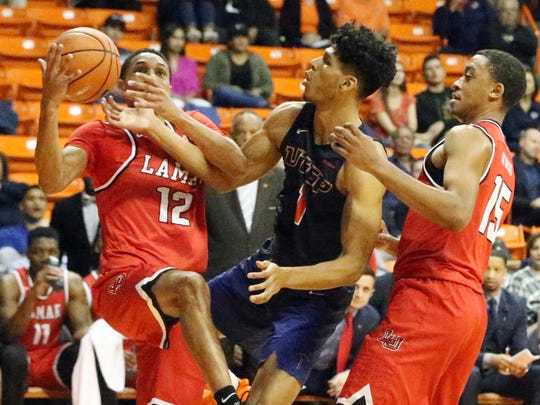 UTEP forward Paul Thomas, 1, battles for a rebound with Zjori Bosha, 12, of Lamar Monday night in the Don Haskins Center. The Miners lost the contest 66-52.