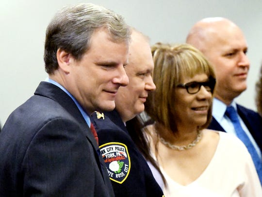 From left, York City Mayor Michael Helfrich, York City Police Chief Troy Bankert and Bankert's wife Mary pose for a photo during a police ceremony at York City Hall Monday, June 11, 2018. Bankert was officially promoted to chief during the event. Bill Kalina photo