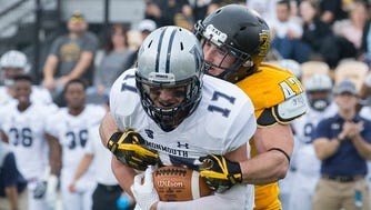 Monmouth's Jake Powell hauls in a pass for first down as Kennesaw State's Bryson Armstrong defends during the Big South Conference game on Saturday Nov. 18, 2017.