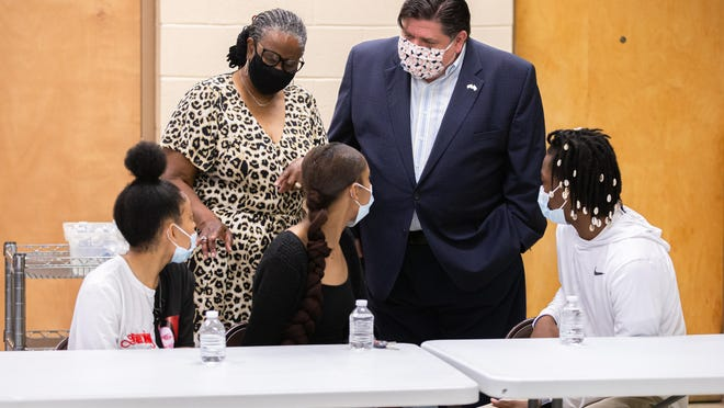 Illinois Gov. JB Pritzker is introduced to Nykia Henderson, left, her twin sister, Nykeyla Henderson,  center, and Derrick Roberts, right, by Ward 3. Ald. Doris Turner as she explains their efforts in organizing local Black Lives Matter protests. Pritzker visited with them and religious leaders during a roundtable discussion at Union Baptist Church, Tuesday, June 9, 2020, in Springfield.
