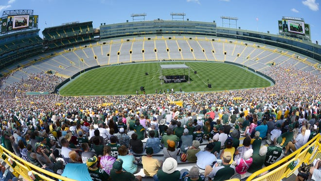 Green Bay Packers shareholders listen to presentations during the 2014 meeting at Lambeau Field.