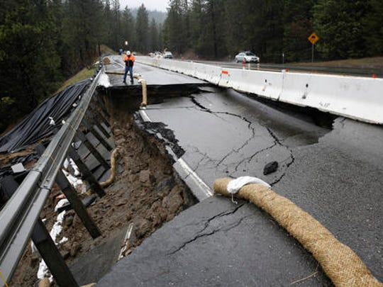 Heavy storms over the past two weeks caused parts of the shoulder and one lane of westbound Highway 50 give way, Tuesday, Feb. 21, 2017, near Pollock Pines, Calif. Crews have one lane open, of the four lane highway, as they work to repair the hole that is about 40 feet long and 17 feet wide on one of the main routes to Lake Tahoe.