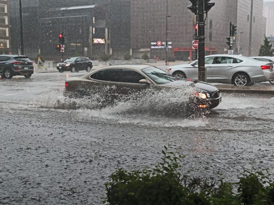 Heavy rains caused flooding on N. 6th St. at the intersection with W. State St. in Milwaukee as thunderstorms rolled through the area.