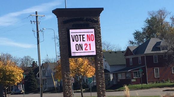Voters early Tuesday appeared to be confused about which measure would cap interest rates on payday lenders.