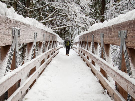 The bridge leading to Bagby Hot Springs can become snow covered in winter.