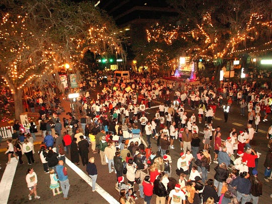 Each year thousands gather at Monroe Street during Winterfest for the Jingle Bell Run.