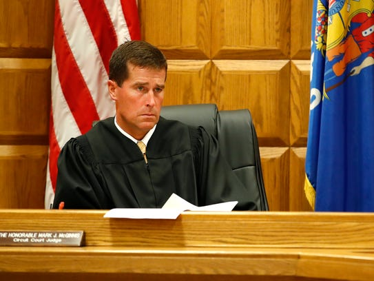 Outagamie County Judge Mark J. McGinnis listens to
