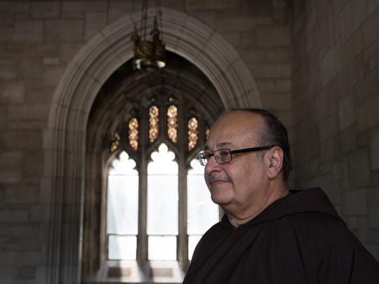 Brother Ronald Giannone, executive director of the nonprofit organization Ministry of Caring, walks through the Cathedral of St. John Church on May 26.