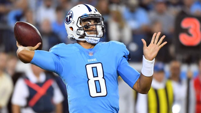 Oct 27, 2016; Nashville, TN, USA; Tennessee Titans quarterback Marcus Mariota (8) completes a pass in the second half against the Jacksonville Jaguars at Nissan Stadium. The Titans won 36-22. Mandatory Credit: Christopher Hanewinckel-USA TODAY Sports