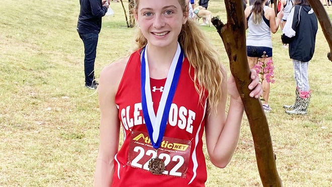 Glen Rose High School's Jocelyn Mims is pictured in Keene with the third-place medal she earned there Wednesday in the first cross country meet of the 2020 season.