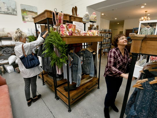 Linda Fisher, right, and Sandi Hanna shop at the Back