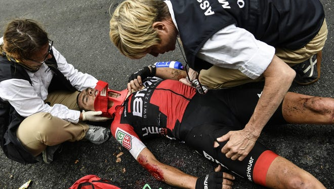 Australia's Richie Porte receives medical assistance after falling during the ninth stage of the Tour de France.