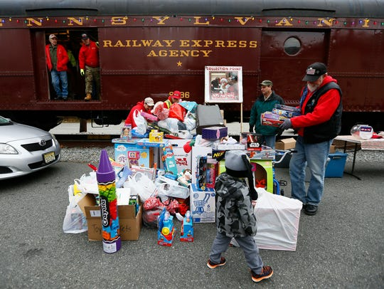 Marine Corps Toys for Tots train arrives at Potbelly's