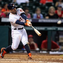 Sep 2, 2014; Houston, TX, USA; Houston Astros second baseman Jose Altuve (27) drives in a run with a double during the eighth inning against the Los Angeles Angels at Minute Maid Park. Mandatory Credit: Troy Taormina-USA TODAY Sports