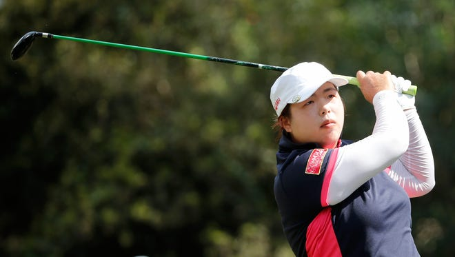 Shanshan Feng of China plays a shot on the sixth hole during the final round of the CME Group Titleholders at Tiburon Golf club on Sunday in Naples, Fla.
