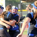 Deposit players celebrate after winning the Class D state softball championship over Hamilton in South Glens Falls. Deposit won, 10-3.