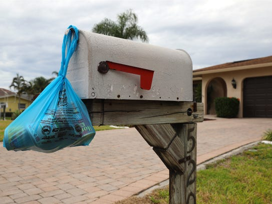 A two- to three-pound bag of canned goods like this one hanging on a Cape Coral mail box can provide two to three meals when mixed with other things, according to Harry Chapin Food Bank CEO Richard LeBer. Cape Coral letter carrier Dan Rams was one of hundreds of thousands nationally who collected bundles like this one on Saturday, the 26th annual National Association of Letter Carriers food drive.