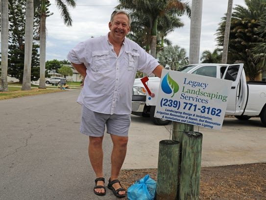 John Harmon, a landscape business owner, stands by his Cape Coral mailbox on Saturday where he placed a bundle of food for his postal carrier, Dan Rams, to collect as part of the National Association of Letter Carriers 26th. annual food drive.