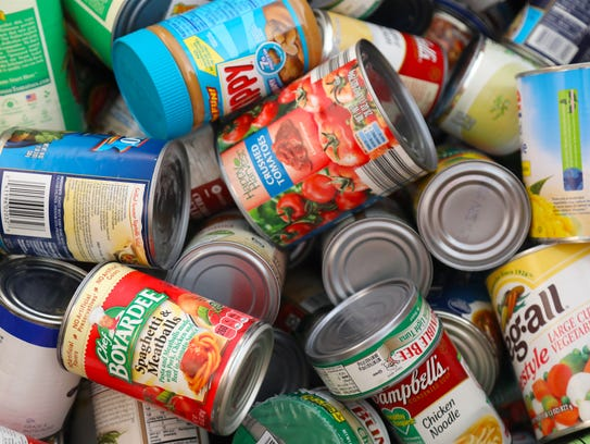 Donated canned goods stack up at Fort Myers' Page Field