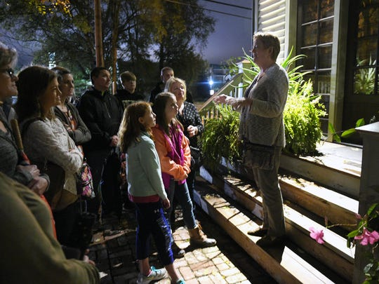 Franklin on Foot's Ghost tour guide Margie Thessin shares ghost stories in downtown Franklin on Thursday, Oct. 20, 2016.