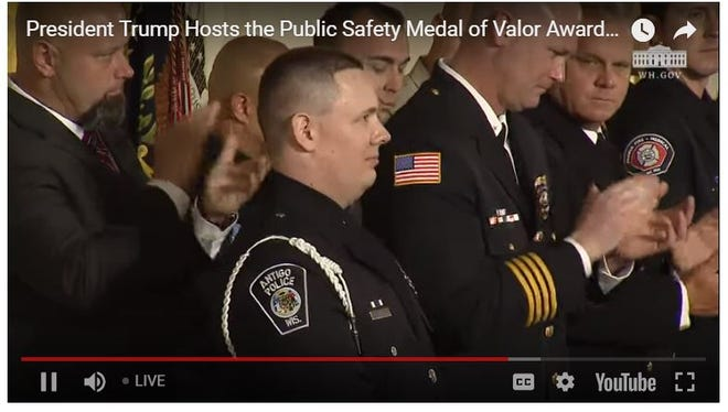 In this image of an online video from the White House, Antigo Police Officer Andy Hopfensperger Jr. receives praise from President Donald Trump on Tuesday, Feb. 20, 2018, during a Medal of Honor ceremony.
