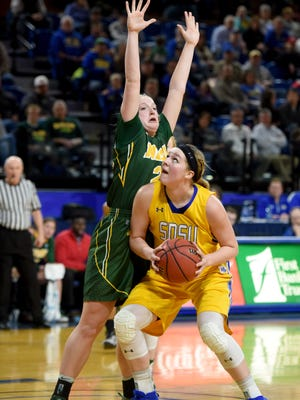 SDSU's Ellie Thompson looks toward the basket while NDSU's Rylee Nudell defends during their game at Frost Arena in Brookings on Thursday.