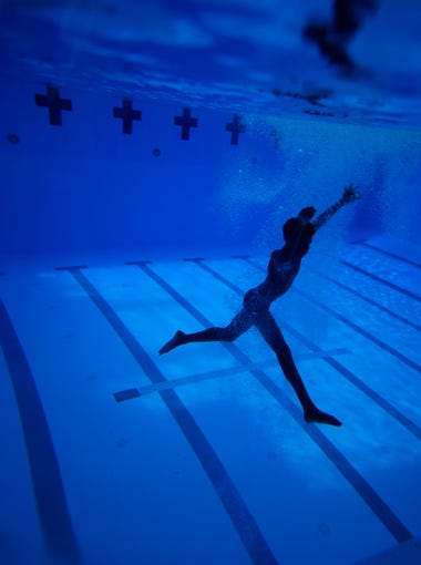 A diver swims underneath the surface during the Tomahawk Diving Team's practice at the Morcom Aquatic Center on Monday, May, 2, 2016.