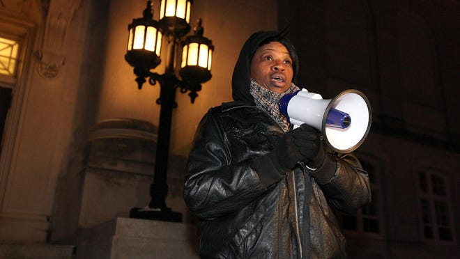Lawanda Reid, widow of Jerame C. Reid, talks to supporters on the steps of the Cumberland County Courthouse during a vigil to remember her late husband.