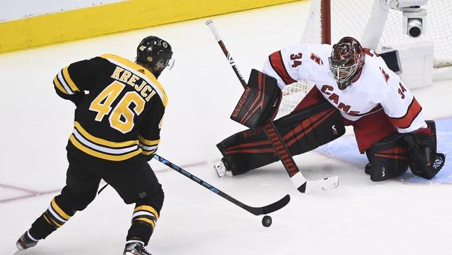 Boston's David Krejci prepares to shoot and score past Carolina goaltender Petr Mrazek during a playoff game last week.