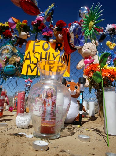 A makeshift memorial for Ashlynne Mike is seen, Wednesday, May 4, 2016 near mile post 12 on Navajo Route 36 in Lower Fruitland.