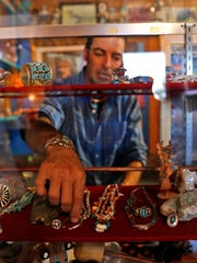 """Jake Chavez, owner of Majestic Enchantment Fly Fishing, talks about jewelry displayed in an art museum on his property. Director Terrence Malick shot footage for his documentary """"Voyage of Time"""" at Chavez's property in Blanco."""