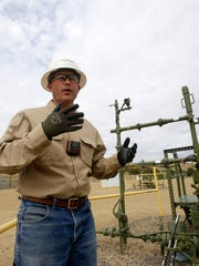 Jamie Huffman, a ConocoPhillips optimization technician, talks on June 30 during a tour of a natural gas site in Aztec.
