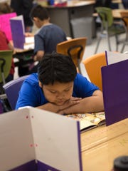 Fourth grader Antonio Begay reads in class on Tuesday at Northeast Elementary School in Farmington.