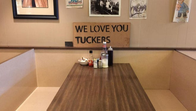 A booth at Tuckers restaurant, before the fire