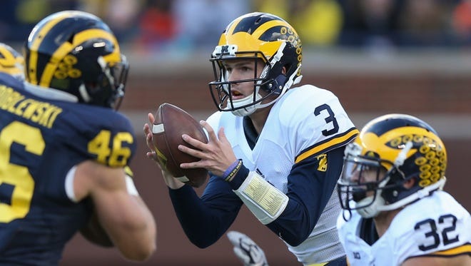 Michigan quarterback Wilton Speight runs the offense during the spring game April 1, 2016, at Michigan Stadium in Ann Arbor.