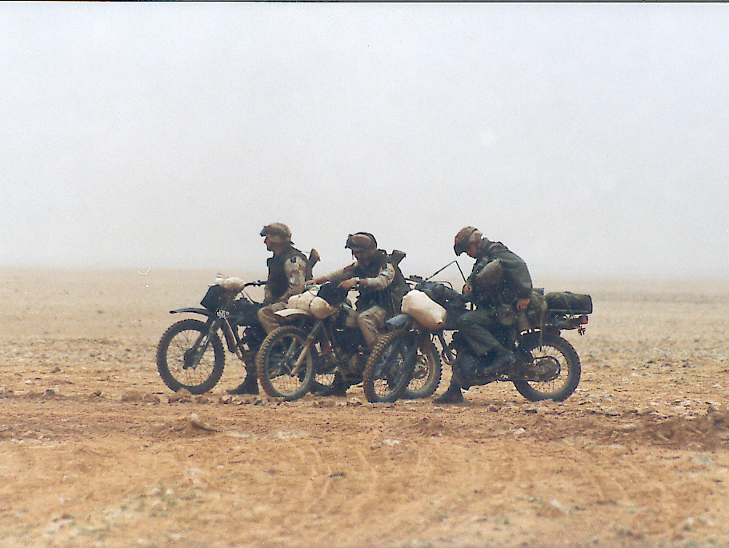 Motorcycle scouts pause during the Gulf War in 1991.