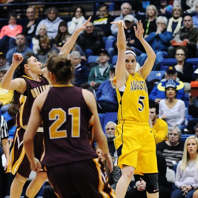 Augustana's Sophie Kenney (5) takes a shot during a