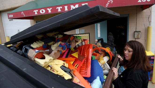 Dawn Hite, president of the Richland Outreach Center, looks at recent toy donations in front of Toy Time on Tuesday.