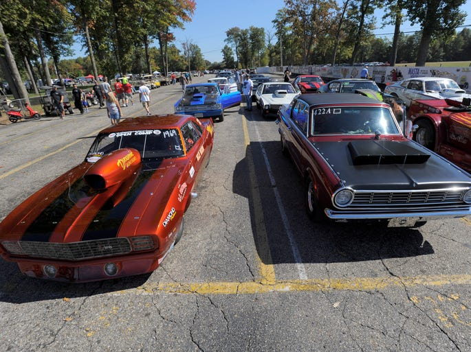 Vintage drag cars line up in the staging lanes Saturday during nostalgia drag racing at Milan Dragway in Milan.