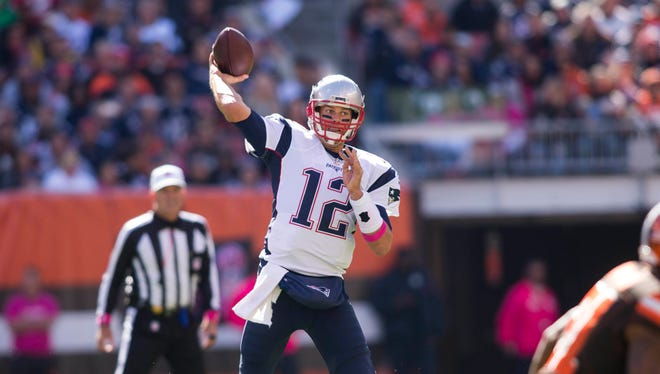 New England Patriots quarterback Tom Brady (12) throws a pass during the first quarter against the Cleveland Browns at FirstEnergy Stadium.