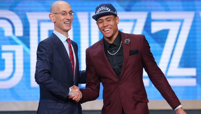 Vanderbilt's Wade Baldwin IV greets NBA Commissioner Adam Silver after being selected 17th overall by the Memphis Grizzlies on Thursday.