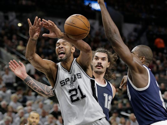 San Antonio Spurs forward Tim Duncan (21) is fouled by Oklahoma City Thunder forward Serge Ibaka, right, as he tries to score during the second half in Game 1 of a second-round NBA basketball playoff series, Saturday, April 30, 2016, in San Antonio. (AP Photo/Eric Gay)